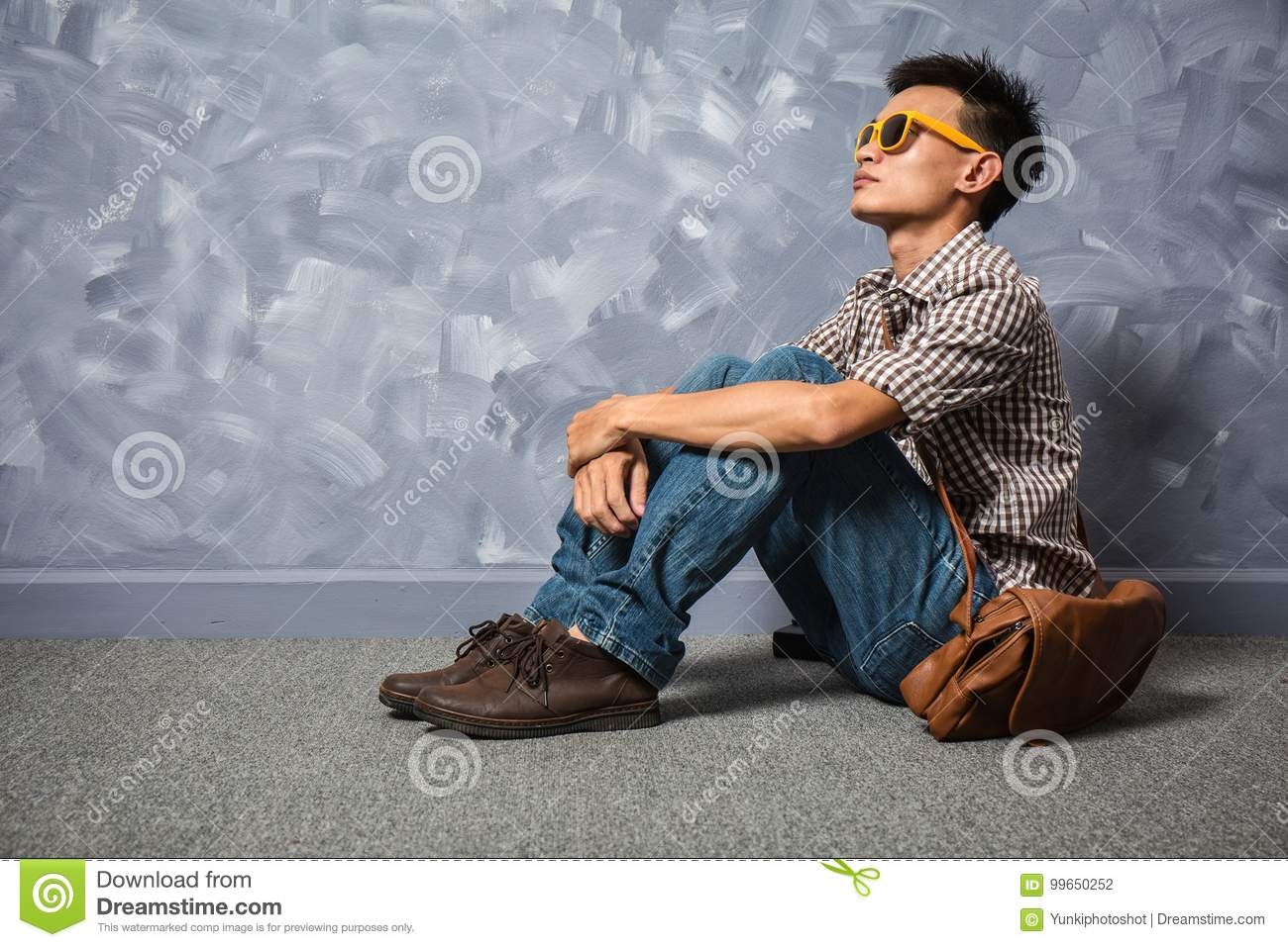 Asian man hipster fashion clothing with glasses and jeans, vintage picture  style.