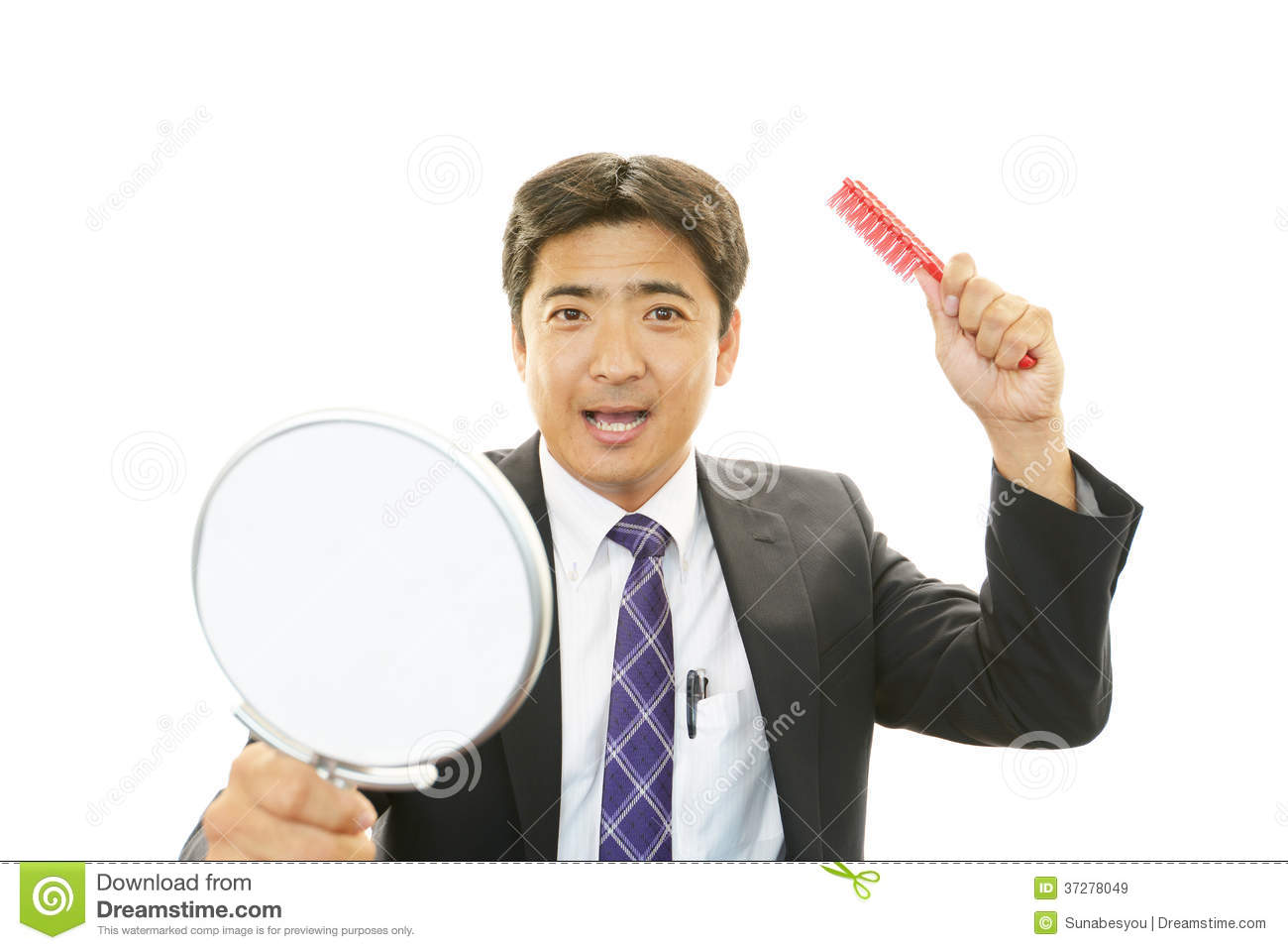Asian Man Holding Hand Mirror With Hairbrush Stock Image