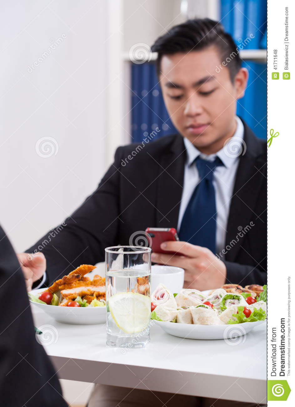 business people working at lunch time stock photography