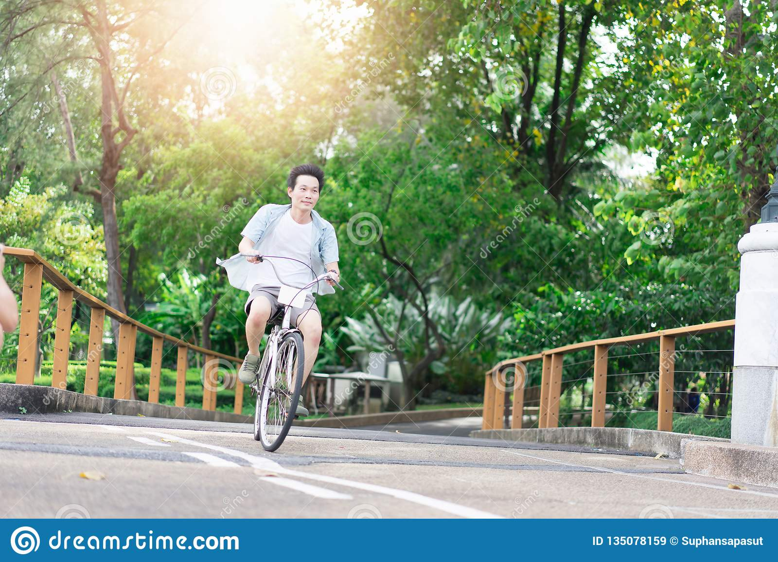 Asian man riding a bicycle for relaxation