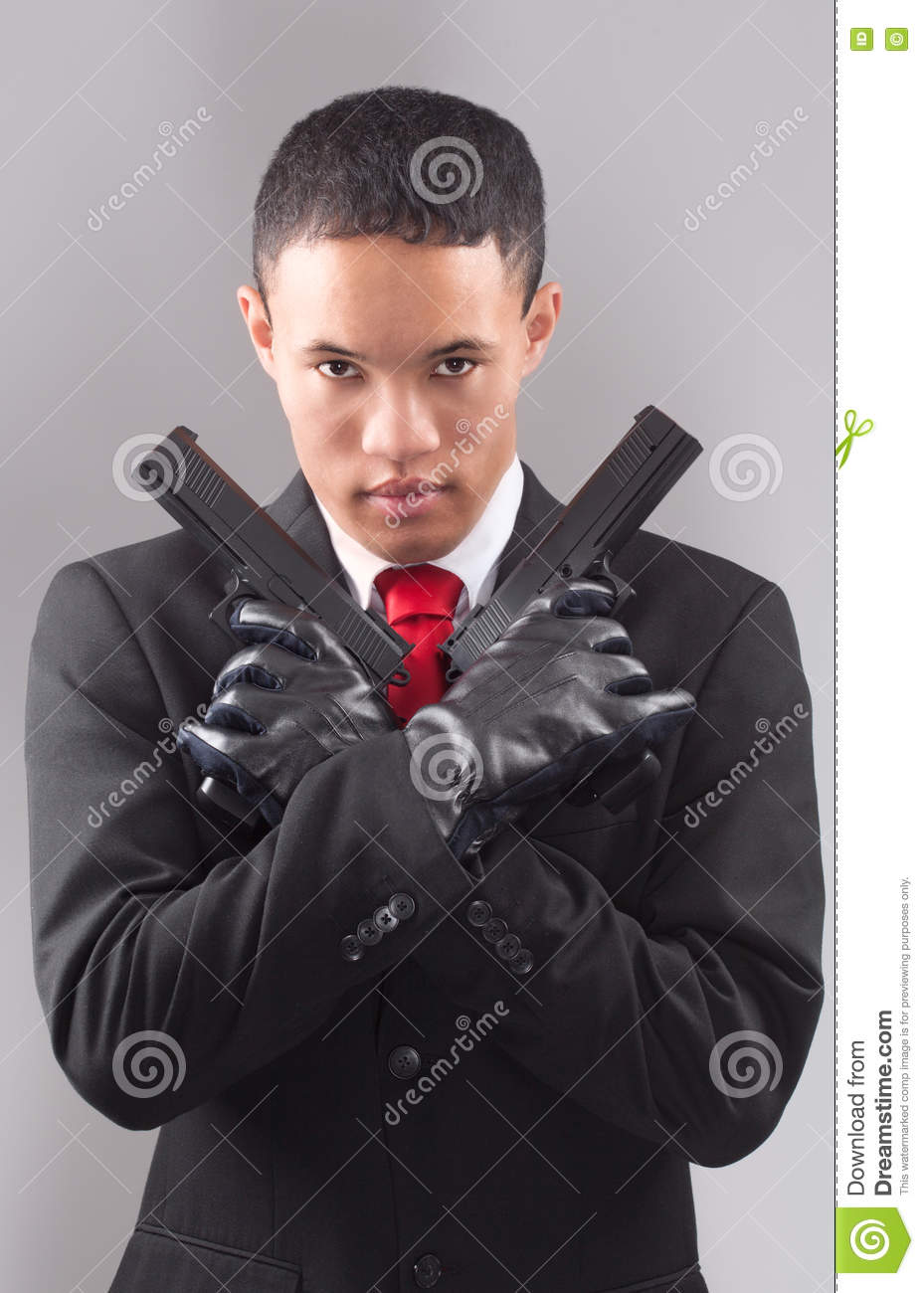asian man in suit and tie with guns stock image image