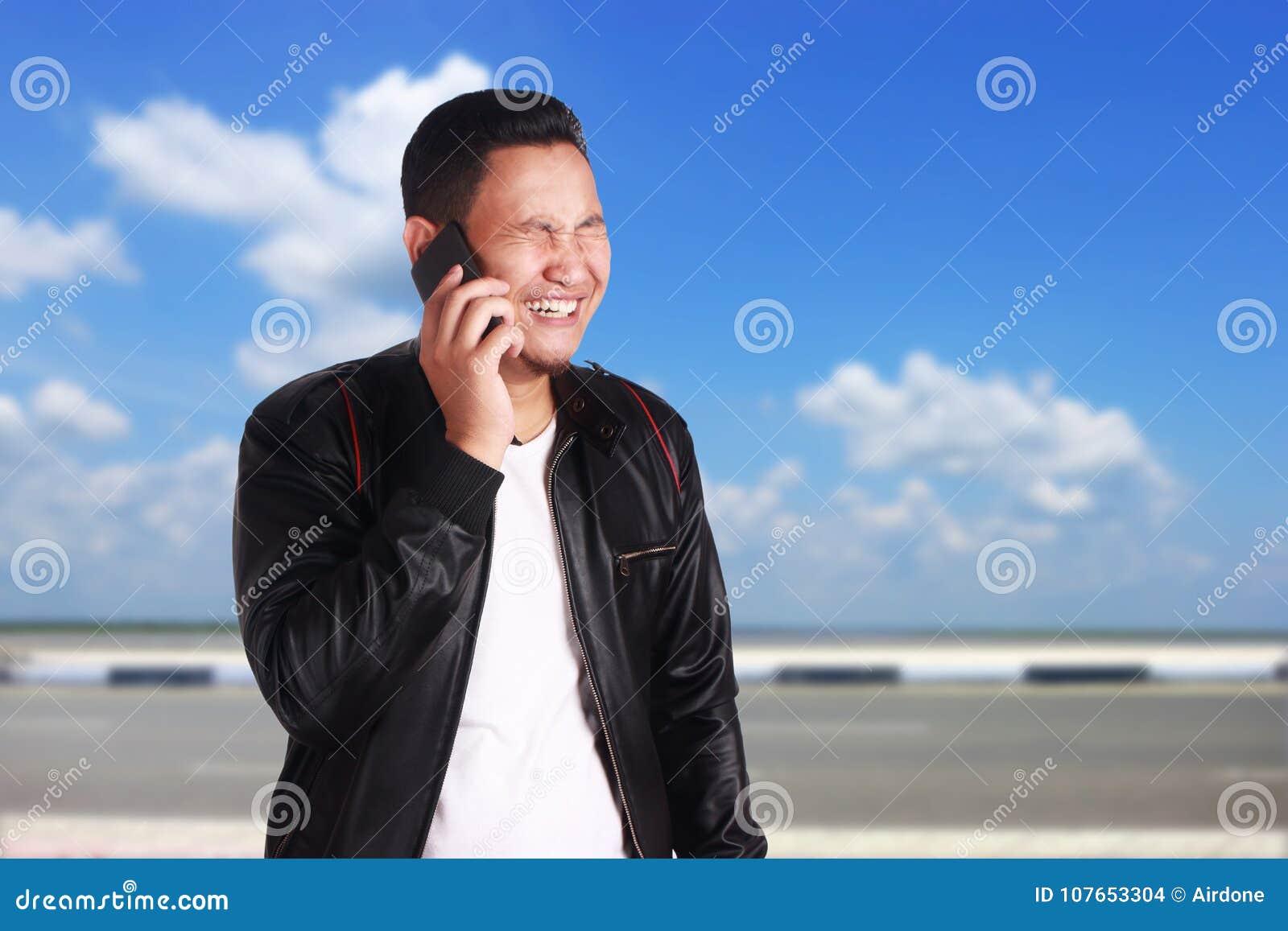 Asian Man Talking On Phone Sad Crying Expression Stock