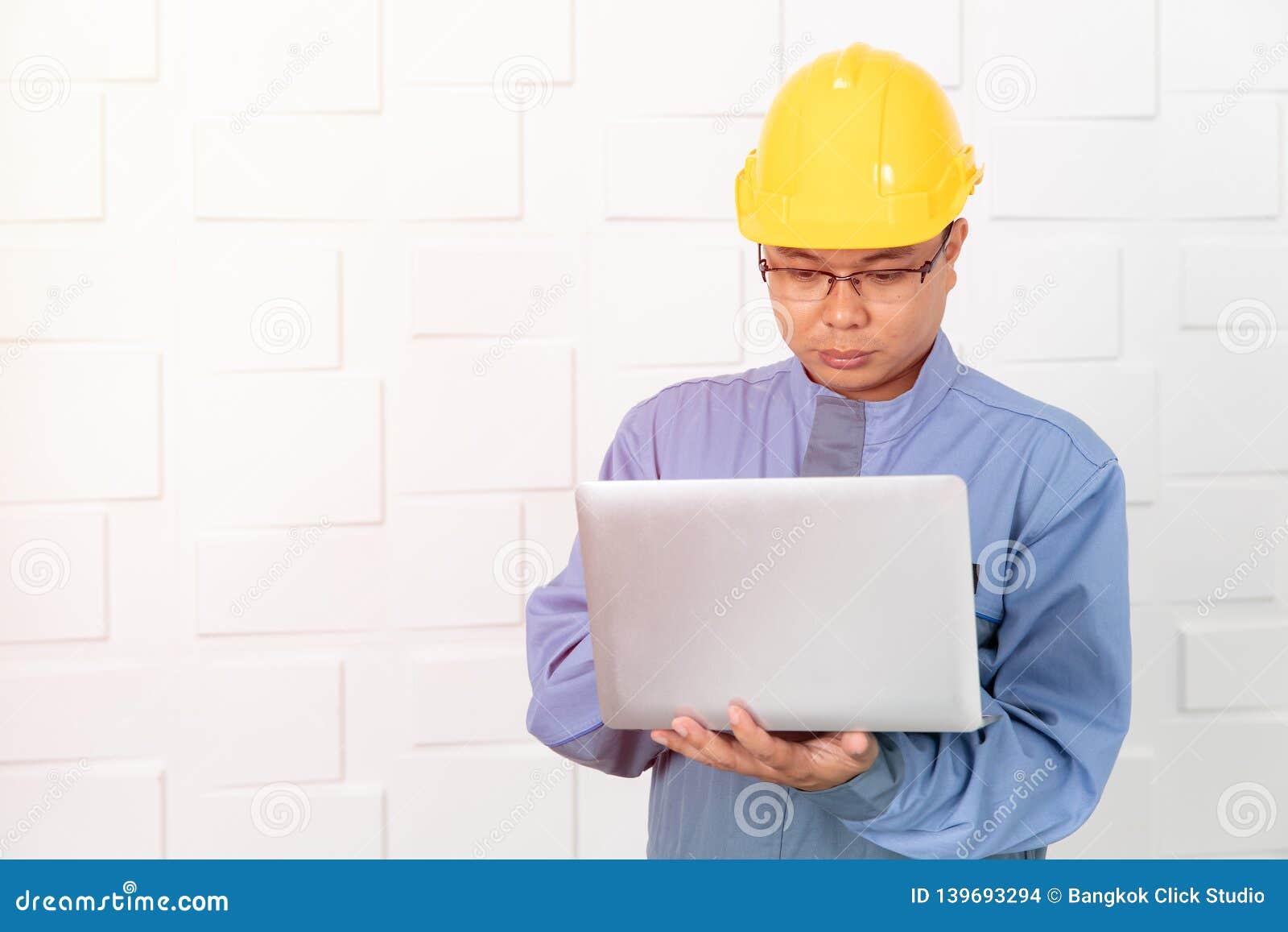 Asian man working