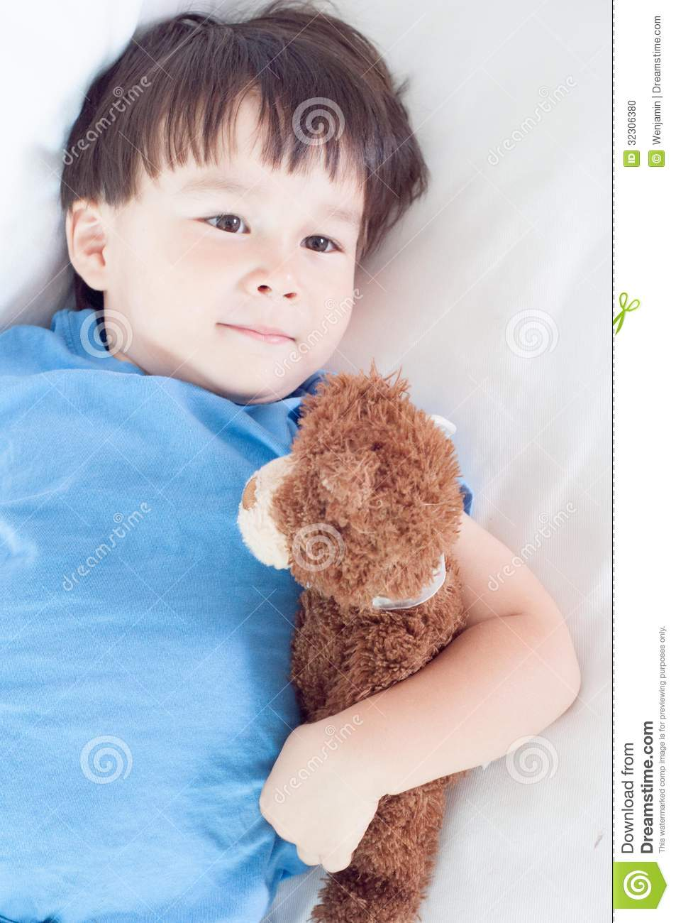 Asian Mixed Race Toddler Boy Lying Holding His Soft Toy