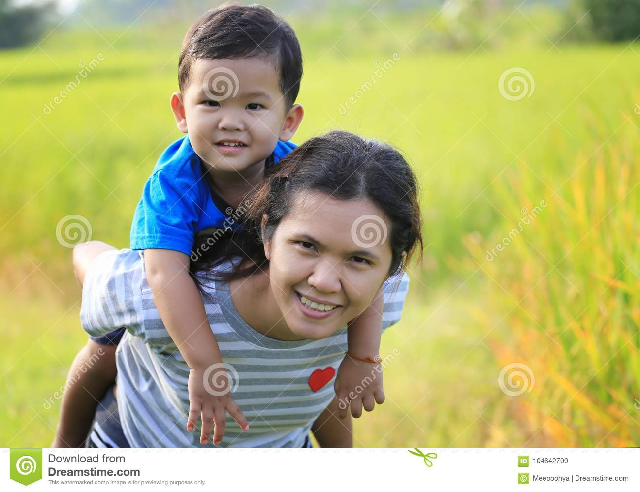 Asian Chinese Woman Carrying Her Toddler Stock Image