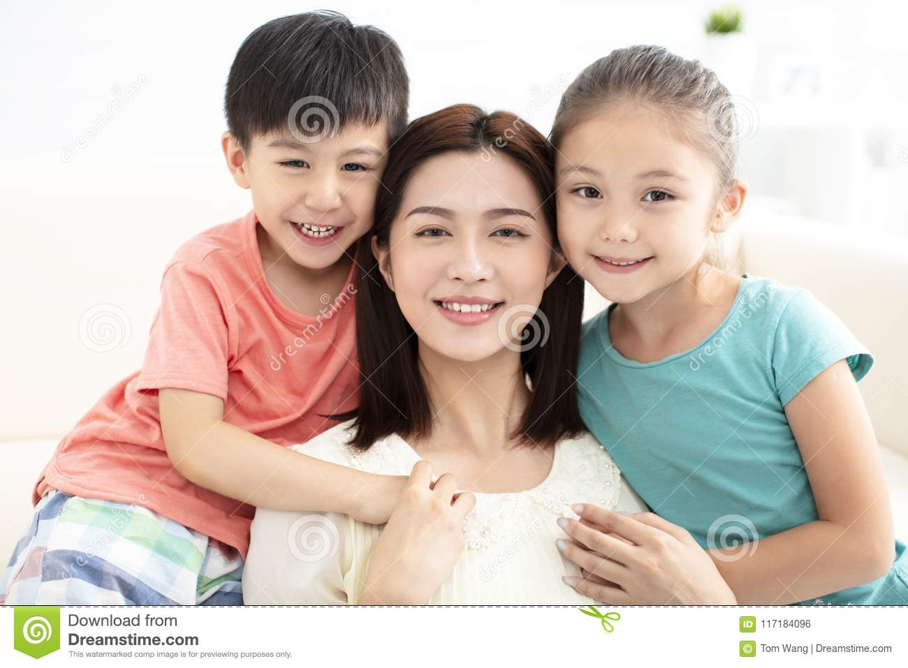 Mother and children smiling on couch