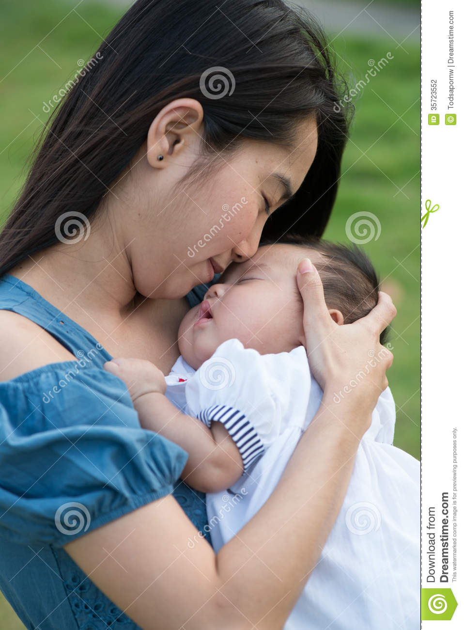 Asian mother kissing the cute baby