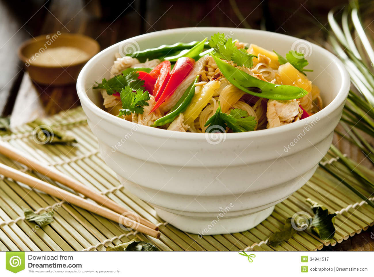 Rice noodle salad with shredded chicken, vegetables and pineapple.