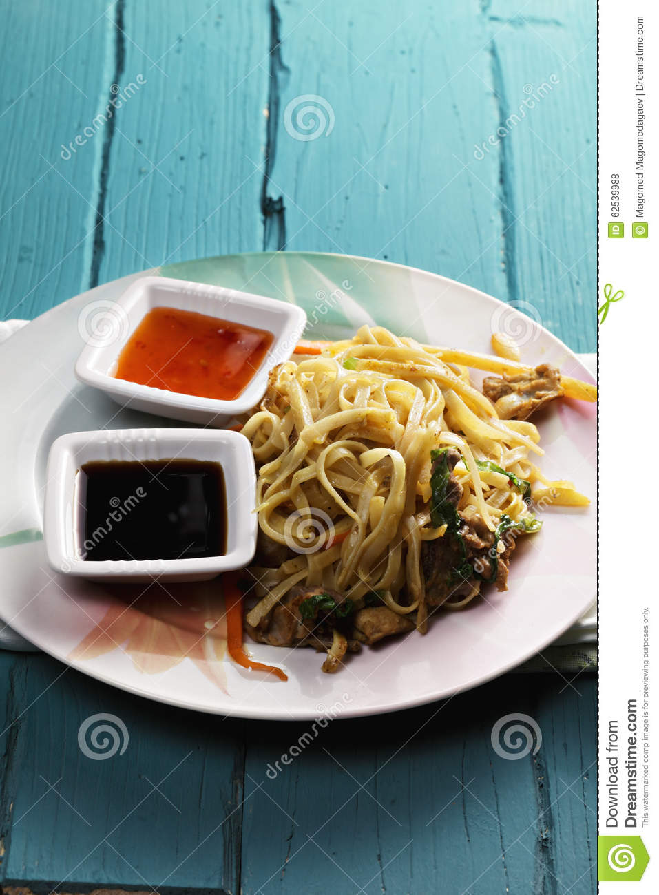 ... stir fried noodles with chicken served with sweet chili and soy sauces