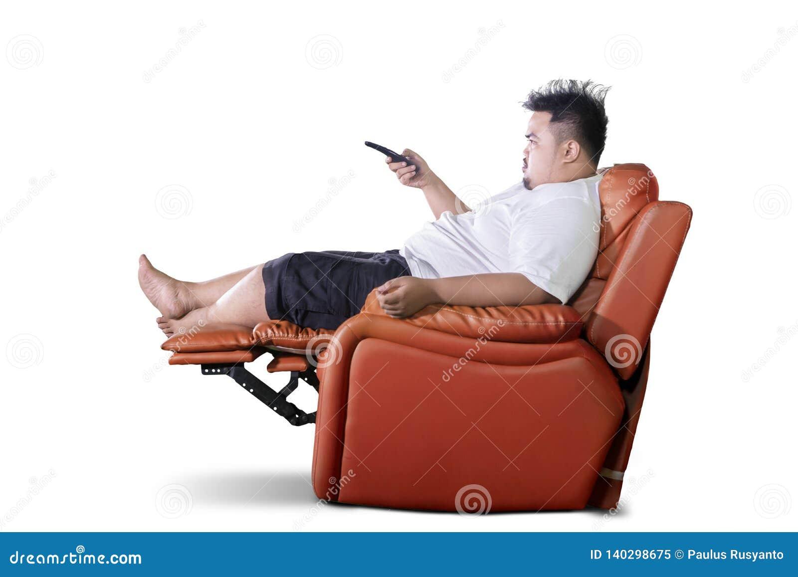 Awe Inspiring Asian Obese Man Watching Television On Studio Stock Image Creativecarmelina Interior Chair Design Creativecarmelinacom