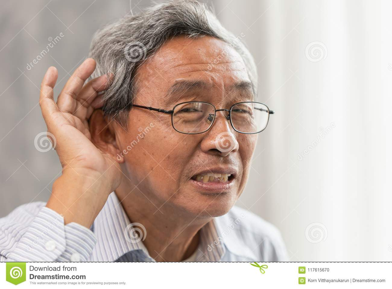 old man with Deaf Hearing problems