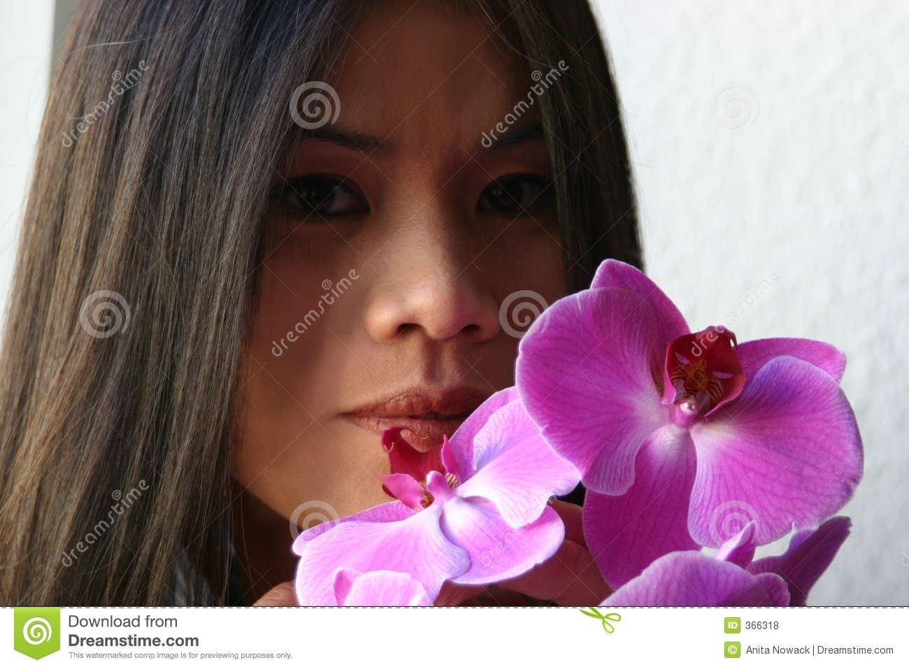 Asian with orchids