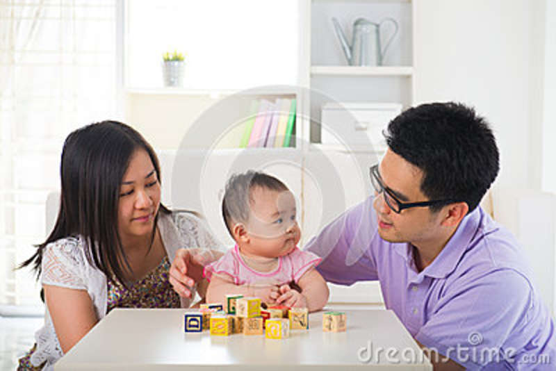 Asian parent playing with baby education concept