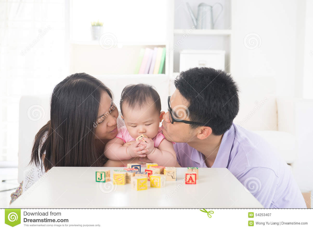 Asian parent playing with baby