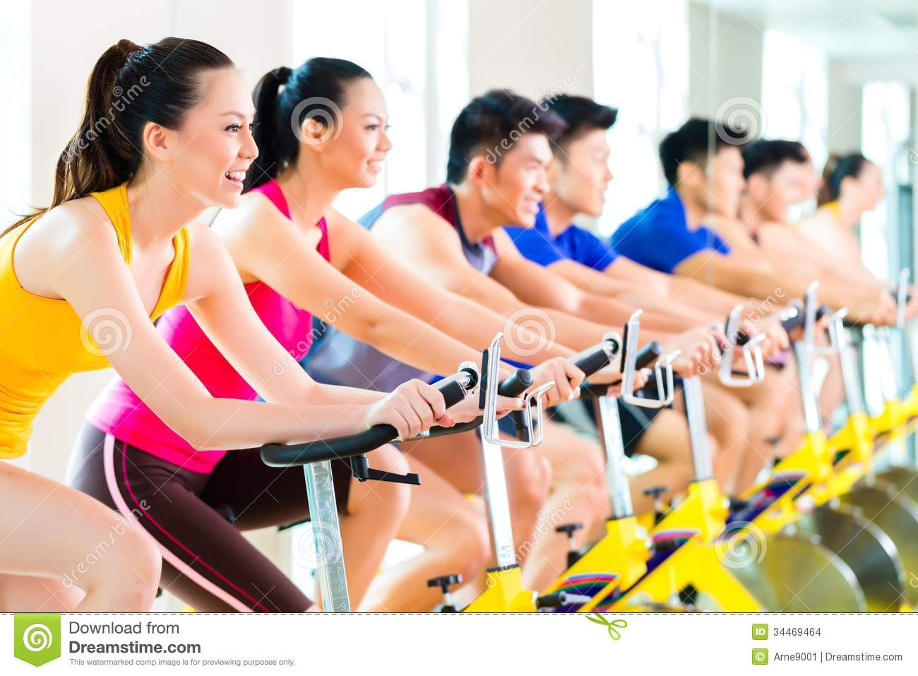 Download Asian People Spinning Bike Training At Fitness Gym Stock Photo