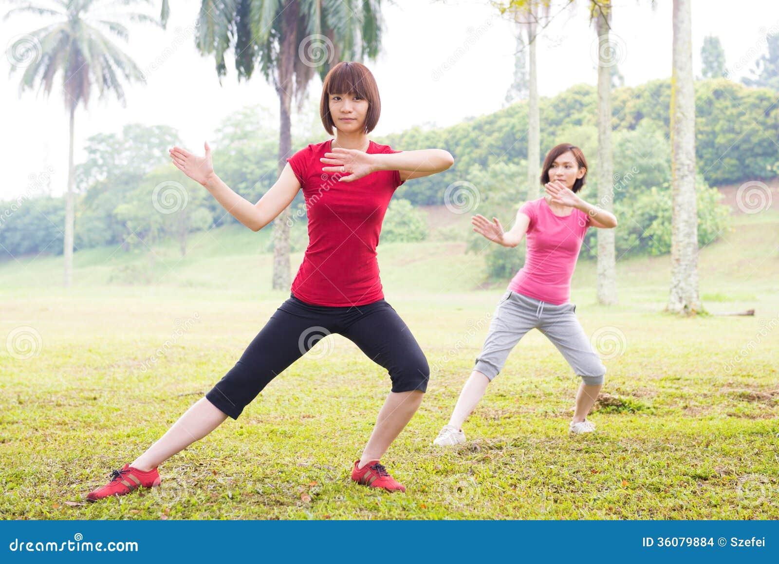 Asian practicing tai chi outdoor