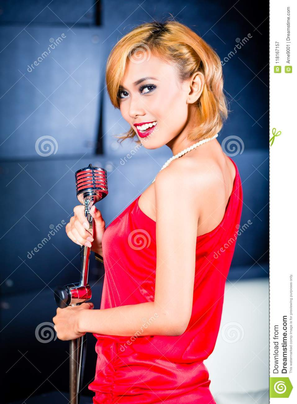 Asian Singer Producing Song In Recording Studio Stock Image - Image