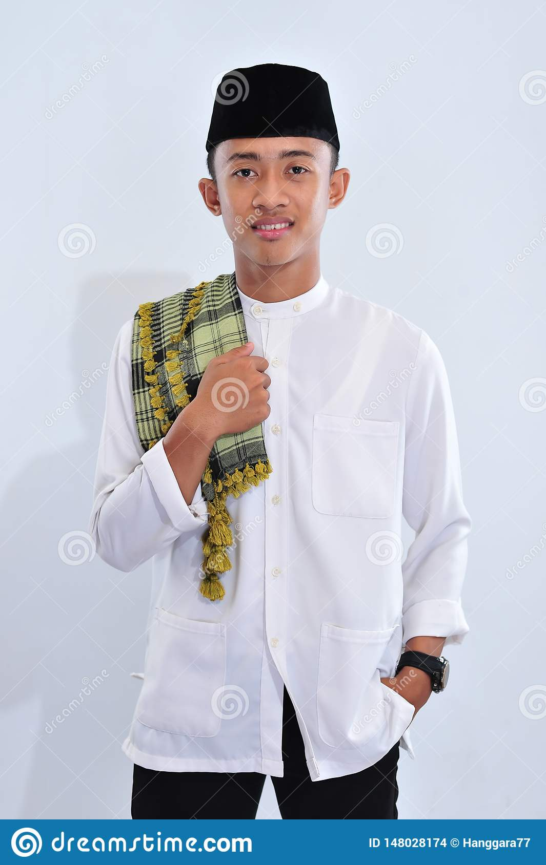 Asian religious muslim man of indonesia smile at you