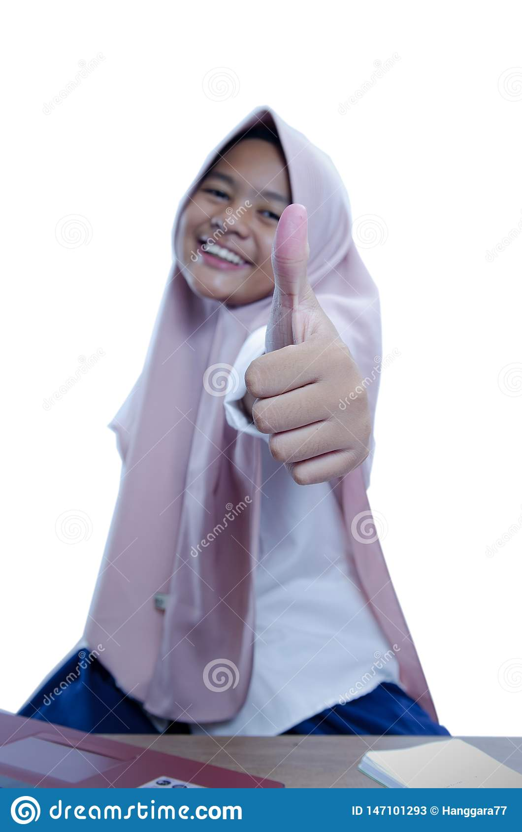 Asian`s businesswoman showing thumb up, wearing hijab, close up