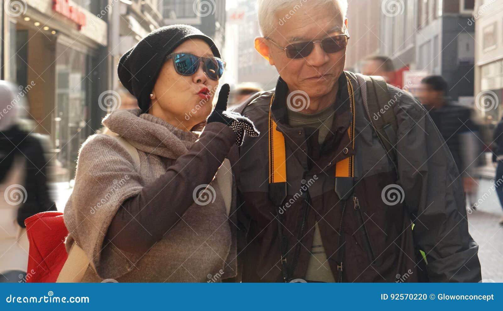 Asian senior couple having fun in Europe retirement anniversary