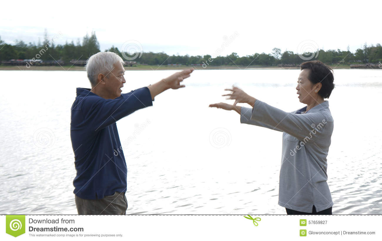 Asian Senior Elderly Couple Practice Taichi, Qi Gong