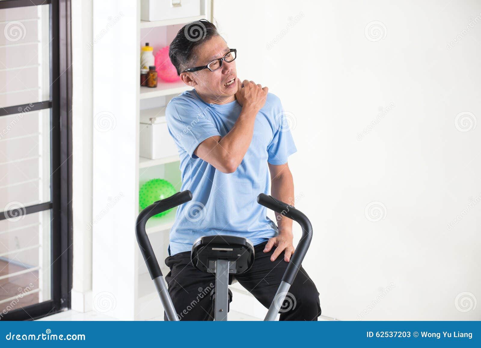 Asian Senior Male Shoulder Injury Stock Image