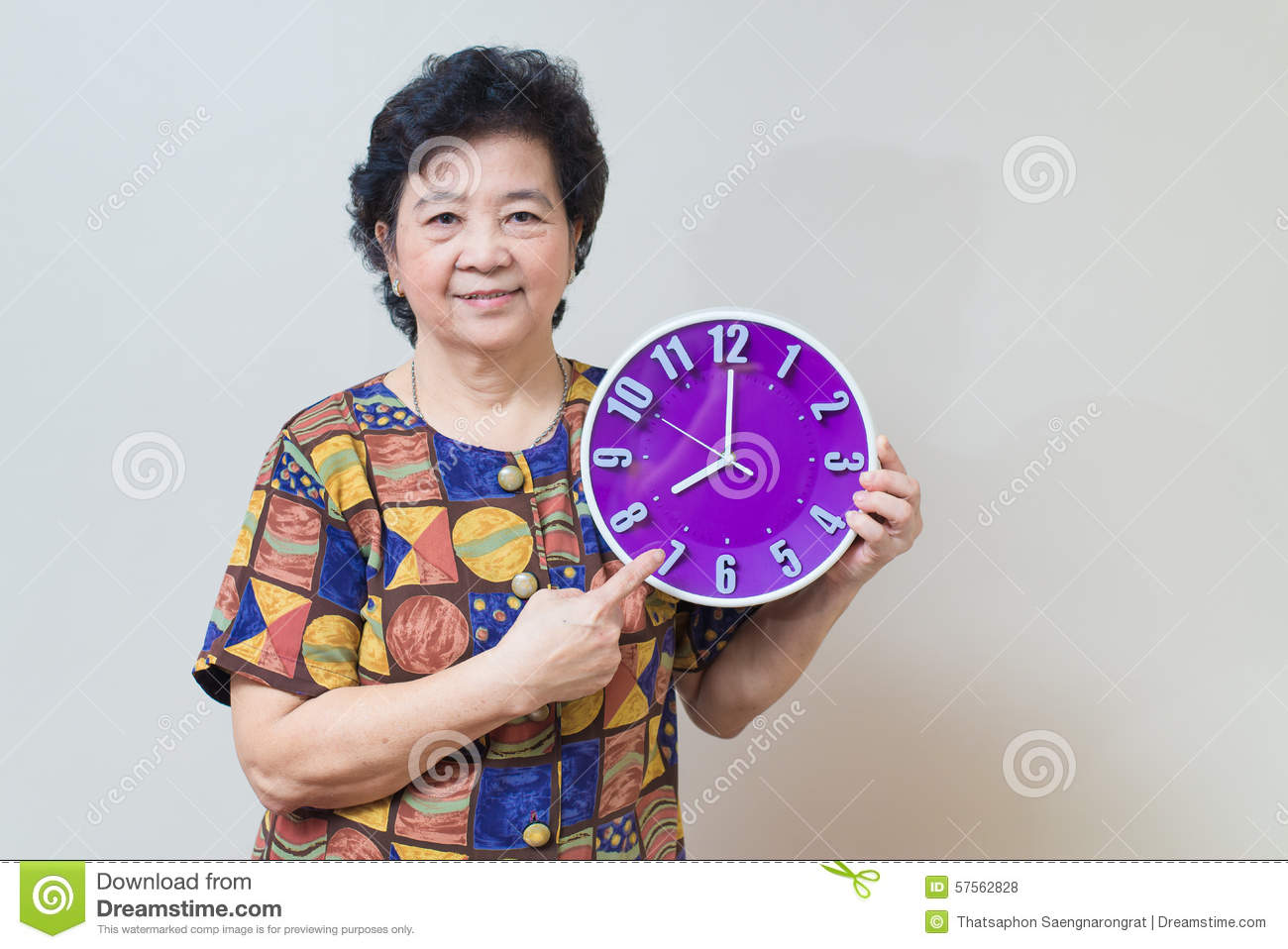 Download Asian Senior Woman Holding Purple Clock In Studio Shot, Specialt Stock Photo - Image of healthy, attractive: 57562828
