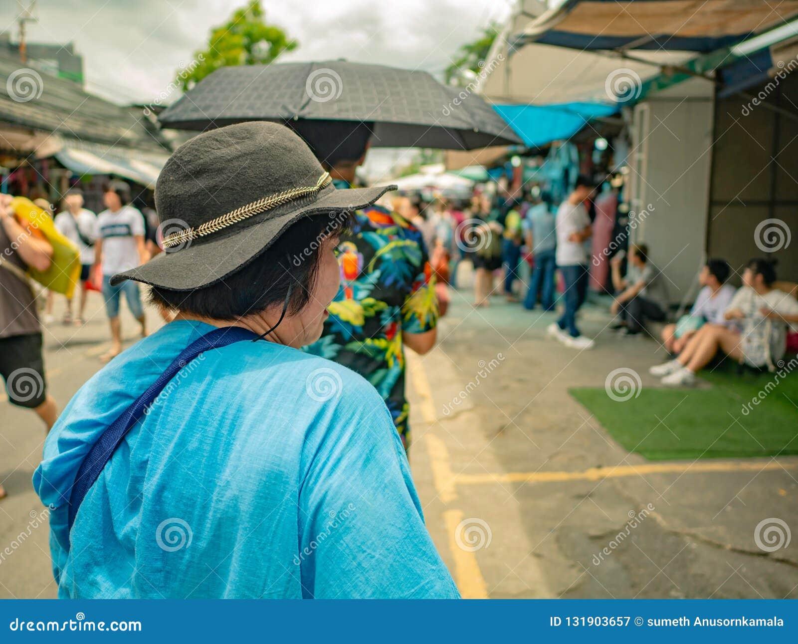 Asian Senior women Shopping in Chatuchak Weekend Market Bangkok