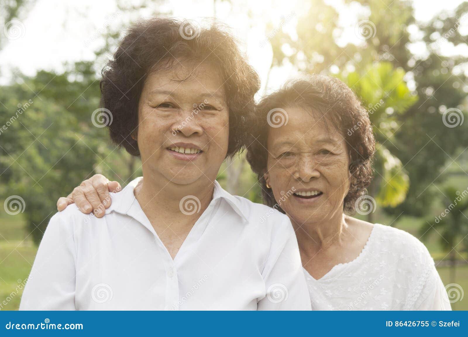 Asian seniors family at outdoor park