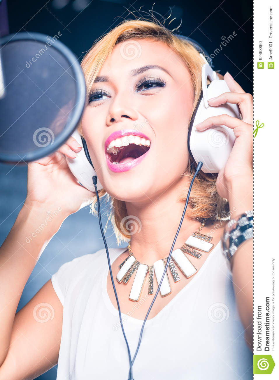 Asian Singer Producing Song In Recording Studio Stock Photo - Image