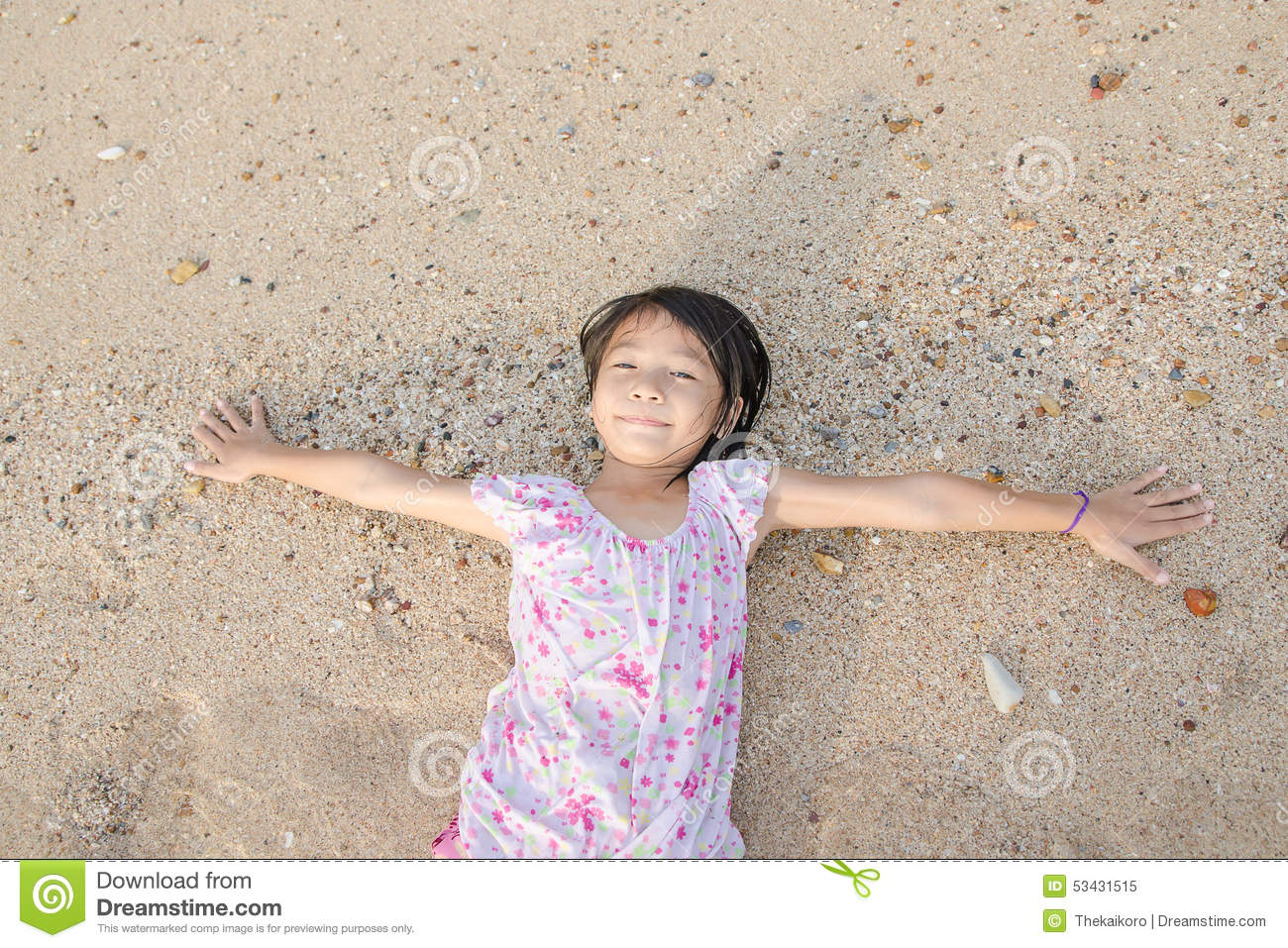 thai child Asian smiling cute little girl lying on the beach sand. Thai chi Royalty Free Stock