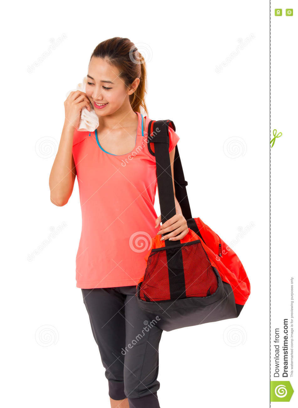 a41c4682918783 Asian Smiling fit young woman with gym bag standing ready for fitness  exercise.