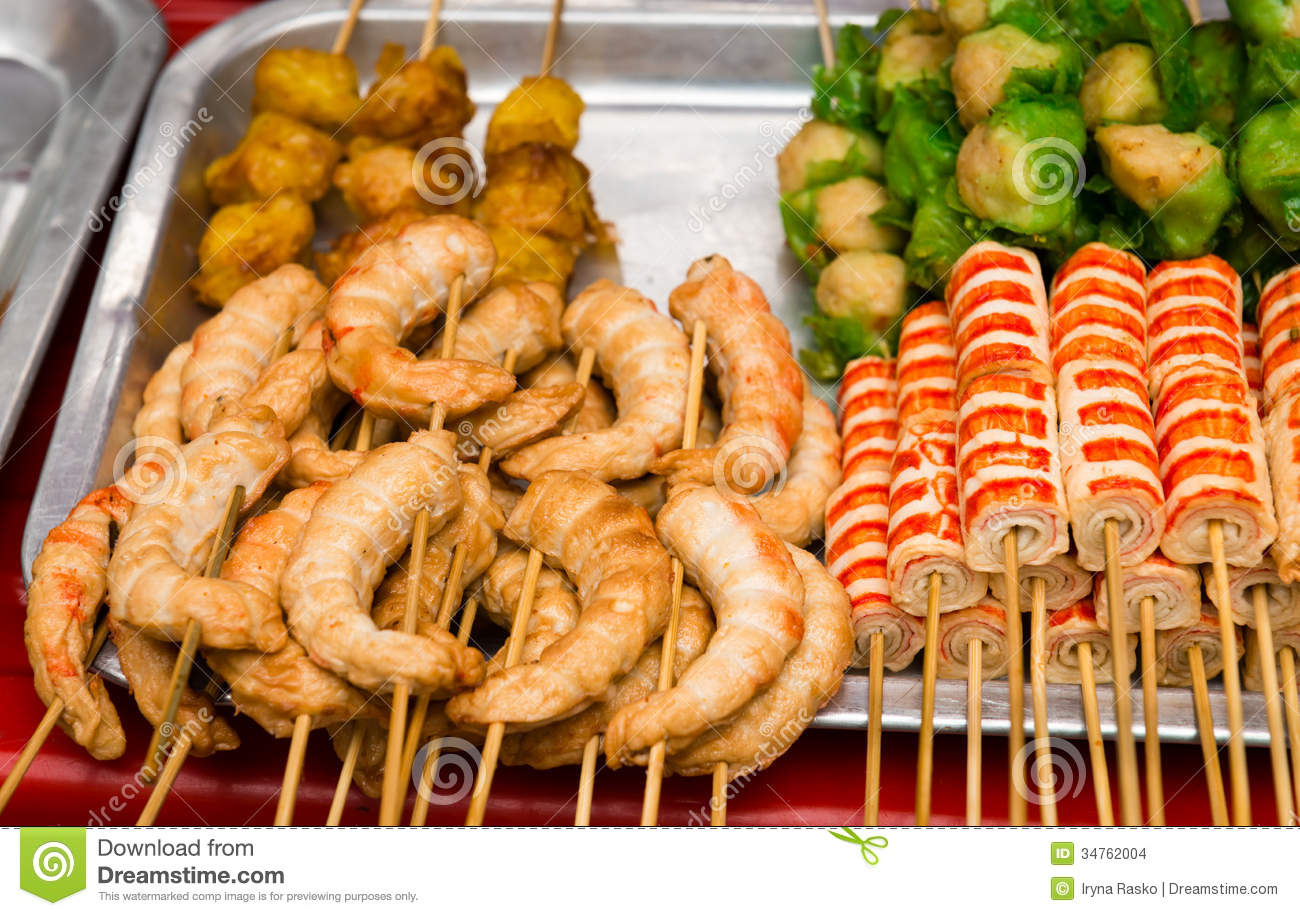 Asian snack with crab meat on a tray of outdoor street food counter.