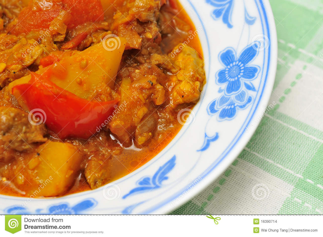 Asian spicy mutton curry cooked with potatoes and tomatoes.
