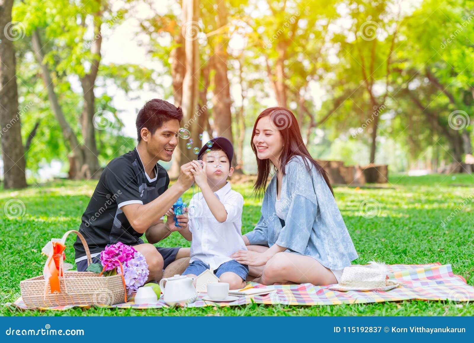 Asian teen family one kid happy holiday picnic