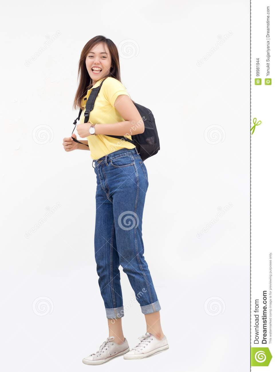 Asian teenage girl jump ping with backpack