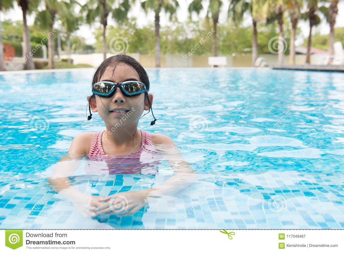 8cc86b356f68 Portrait of Asian teen girl with goggles playing in swimming pool