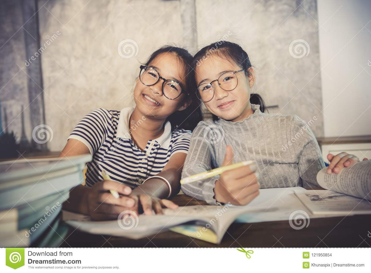 Asian teenager happiness emotion doing school home work