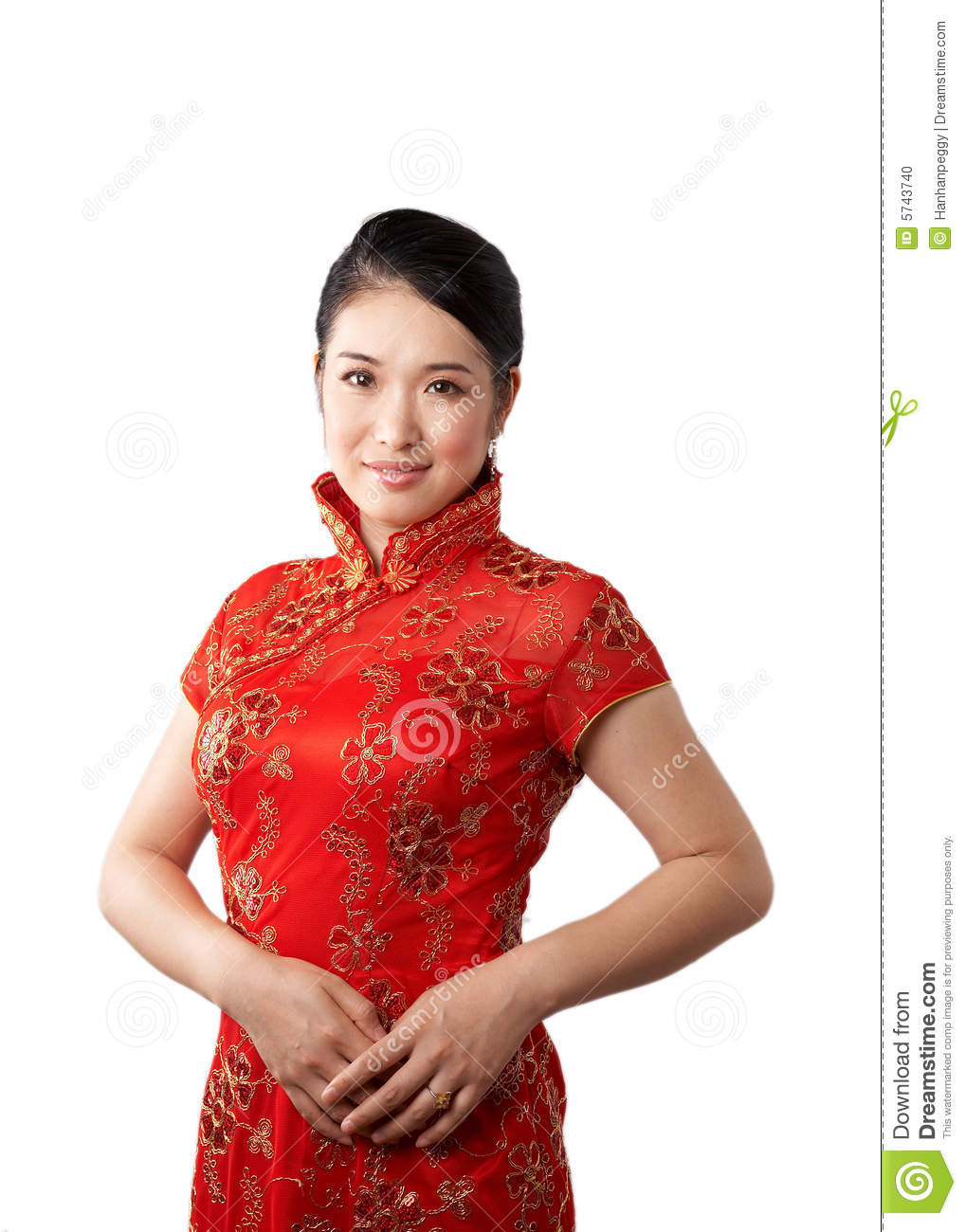 Classy asian woman wearing traditional red cheong sam and holding a
