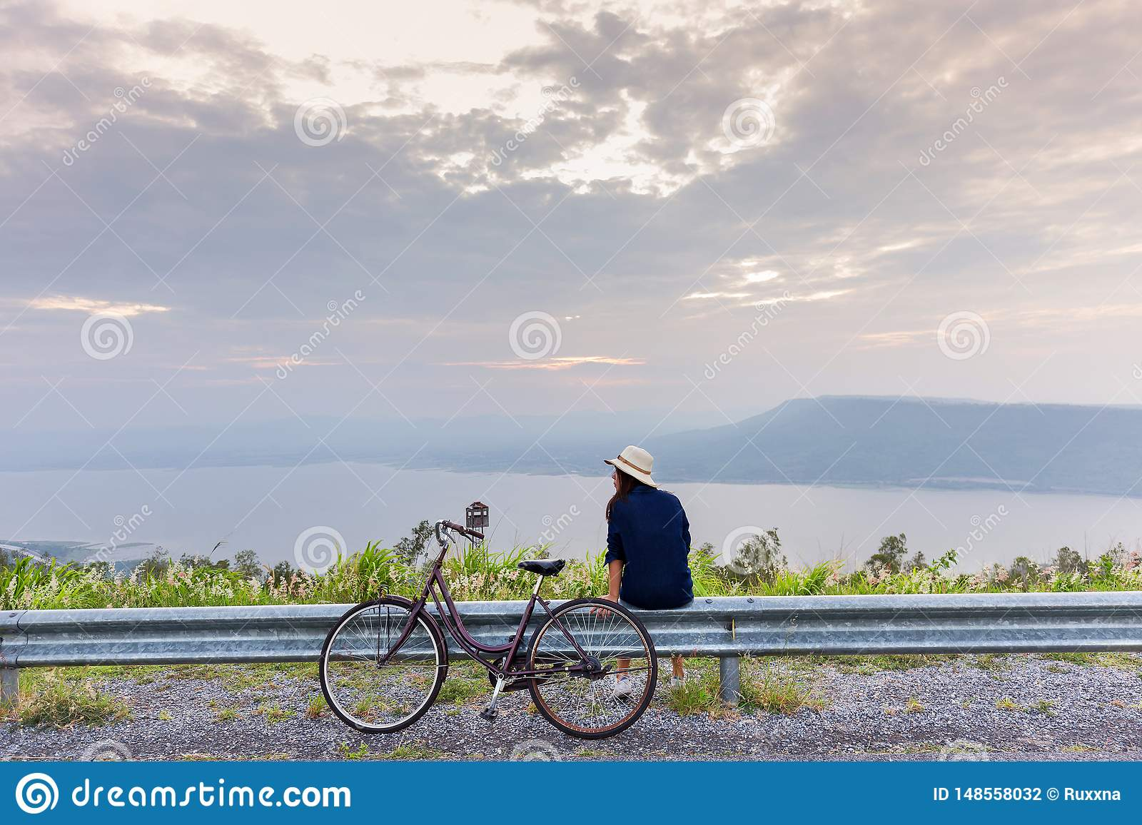 Asian traveler woman in jean dress relaxing holiday