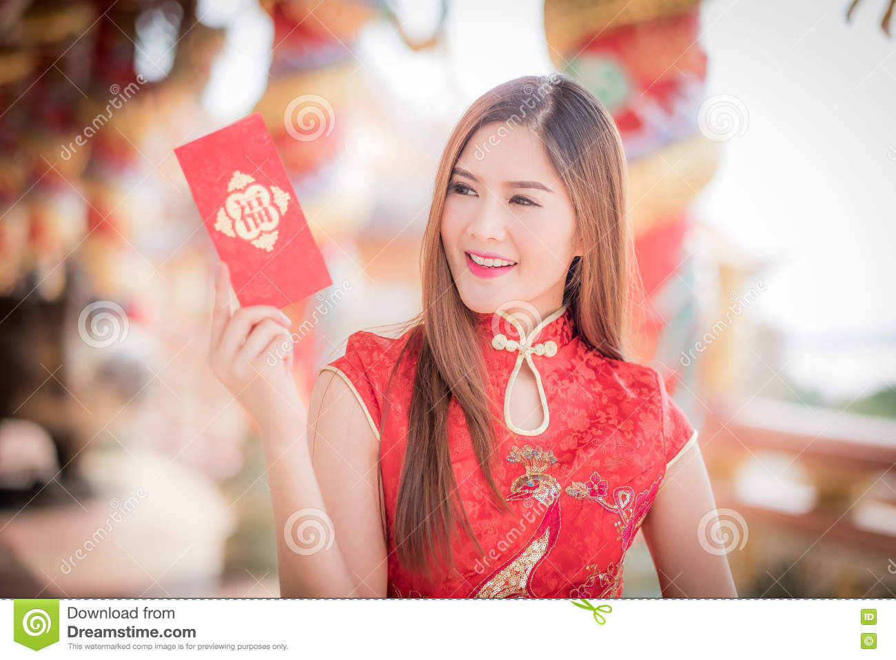 Asian woman in chinese dress holding couplet  Happy  (Chinese w