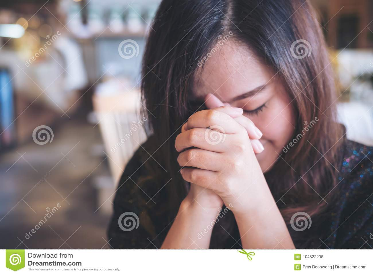 Asian woman close her eyes to praying and wishing for a good luck