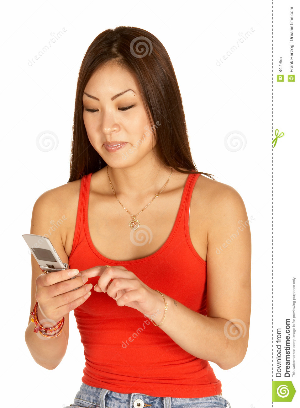 Asian Woman Dialing Cell Phone