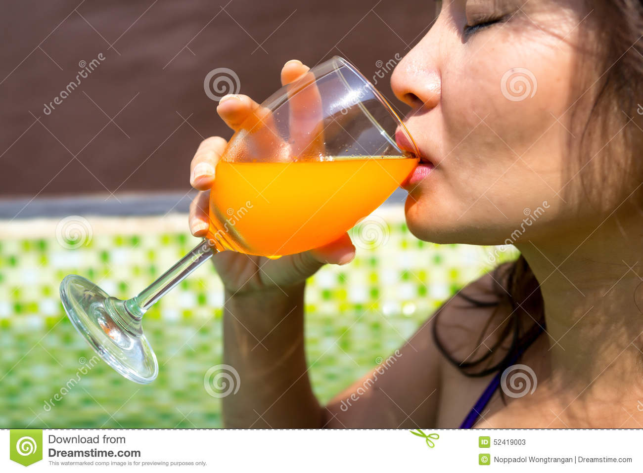 Asian Woman Drinking A Glass Of Cold Orange Juice In The Swimming Pool Stock Photo Image 52419003