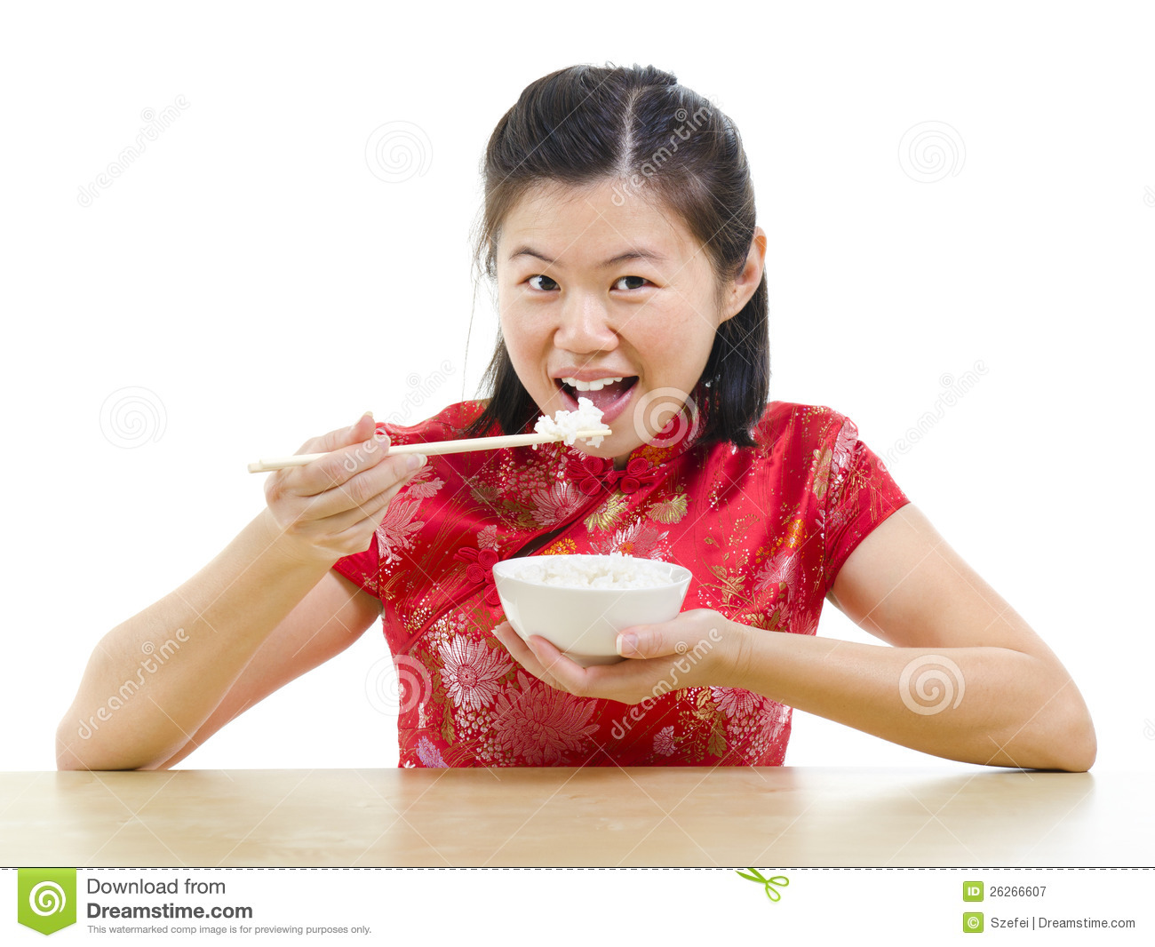 Asian woman eating rice