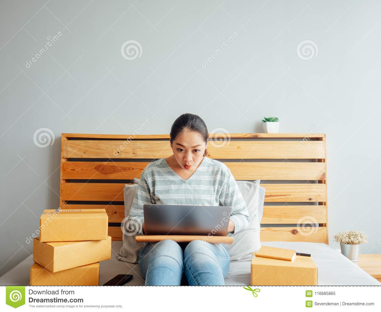 Woman is feeling happy with her online business sales. Concept o