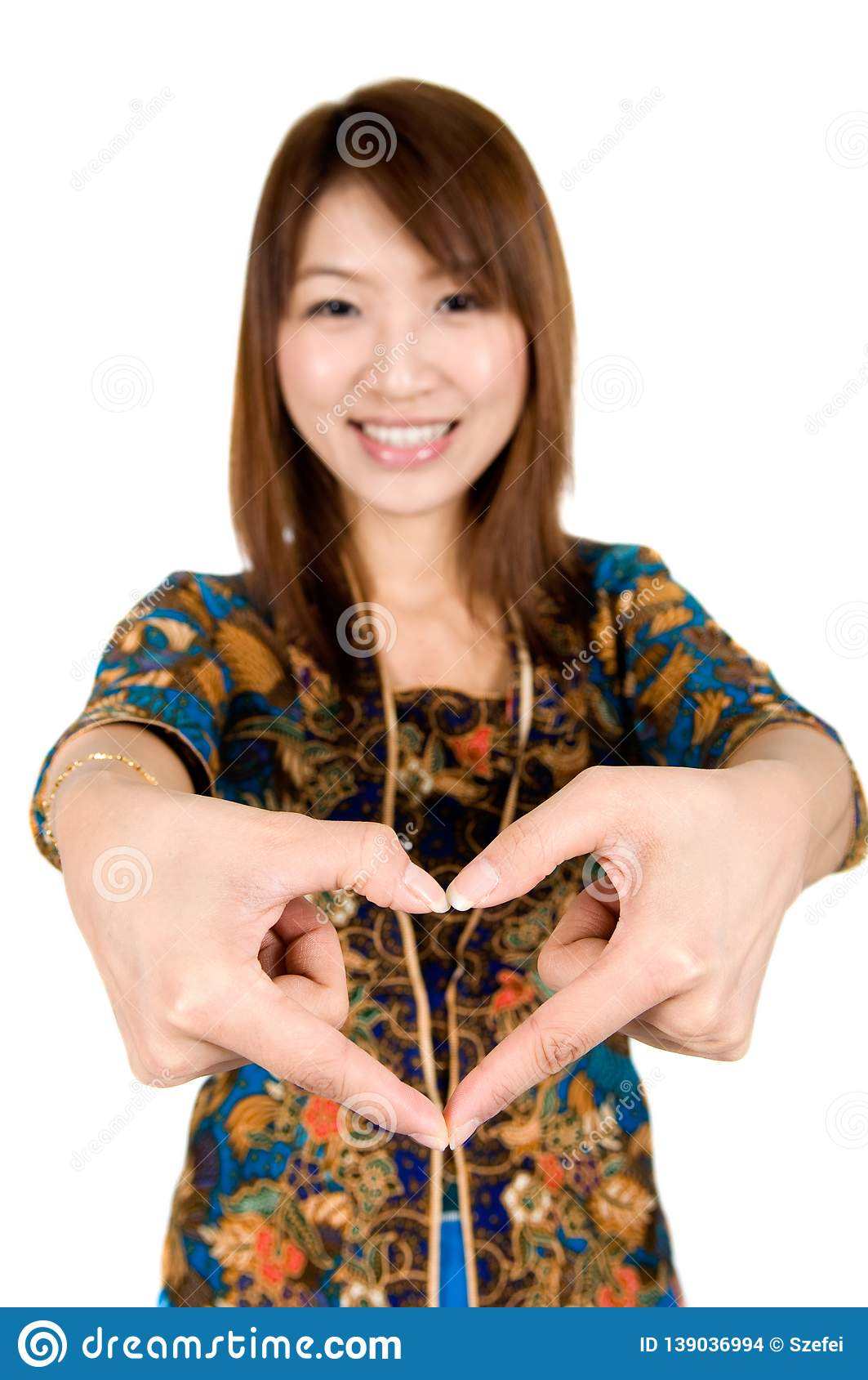 Asian woman hand forming a heart shape