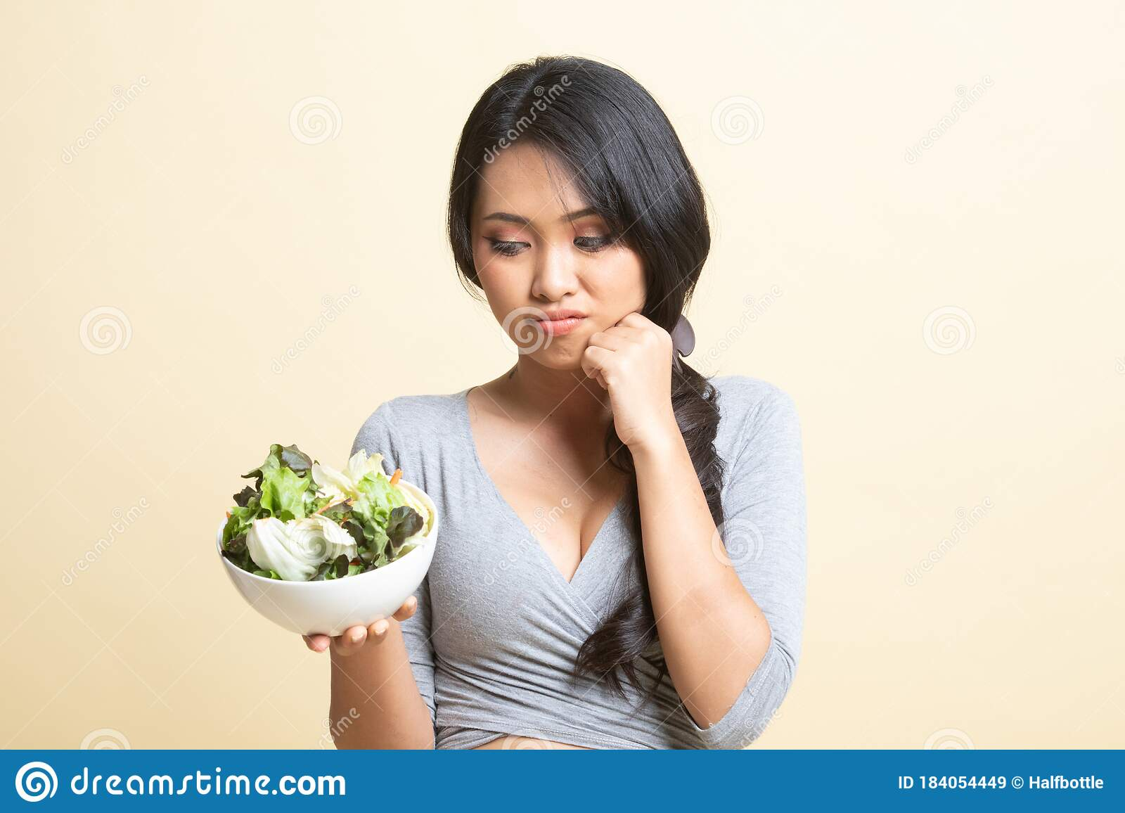 Asian woman hate salad stock image. Image of hate