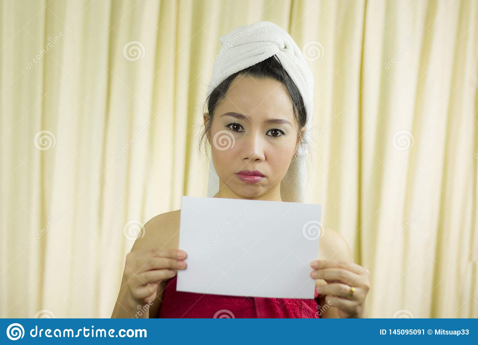 Asian woman holding empty blank banner and acting. she wear a skirt to cover her breast after wash hair, Wrapped in Towels After