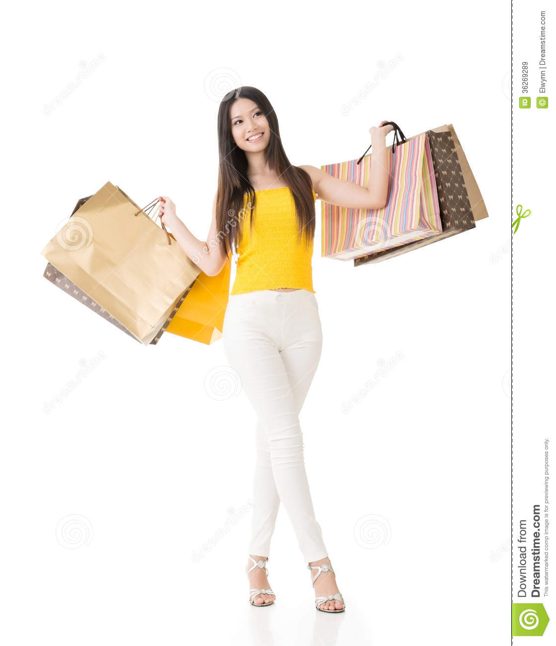 Woman posing with shopping bags isolated on white background full - Asian Woman Holding Shopping Bags Royalty Free Stock Images Asian Attractive Background Bags Full Isolated Length Portrait Shopping Studio White